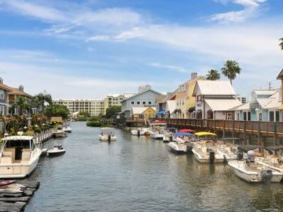 Canal leading out to the Intercoastal Waterway, Gulf Gate boat docks, restaurants, bars, pubs, stores, and shops.